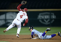 NWA Democrat-Gazette/ANDY SHUPE<br /> Arkansas second baseman Trevor Ezell (4) returns to his feet after applying the tag on Western Illinois center fielder Diego Munoz Tuesday, March 12, 2019, during the fifth inning at Baum-Walker Stadium in Fayetteville. Visit nwadg.com/photos to see more photographs from the game.