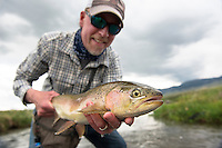 David Thompson of Bozeman, Montana, holds a rainbow trout caught on a small spring creek near Dillon, Montana.