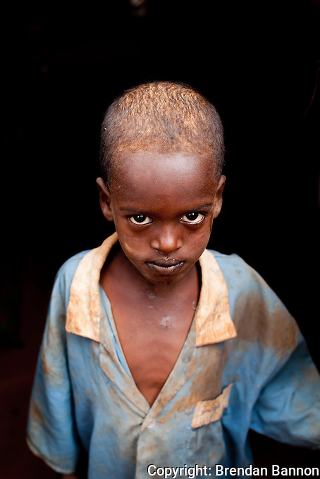 A young Somali boy whose nomadic family fled from Bardere, Somalia to Kenya in May 2011 due to hunger, drought and war. They travelled 32 days by foot and donkey cart relying on the kindness of people along the way for food and water.