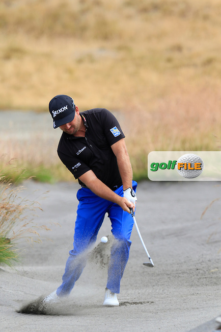 Graeme McDOWELL (NIR) chips from the sand at the 17th green during Thursday's Round 1 of the 2015 U.S. Open 115th National Championship held at Chambers Bay, Seattle, Washington, USA. 6/18/2015.<br /> Picture: Golffile | Eoin Clarke<br /> <br /> <br /> <br /> <br /> All photo usage must carry mandatory copyright credit (&copy; Golffile | Eoin Clarke)