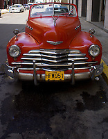 front of a red Chevrolet oldtimer