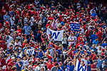 6 October 2017: Washington Nationals fans leave their seats disappointed as Chicago Cubs fans enjoy a first game victory of the NLDS at Nationals Park in Washington, DC. The Cubs shut out the Nationals 3-0 to take a 1-0 lead in their best of five Postseason series. Mandatory Credit: Ed Wolfstein Photo *** RAW (NEF) Image File Available ***