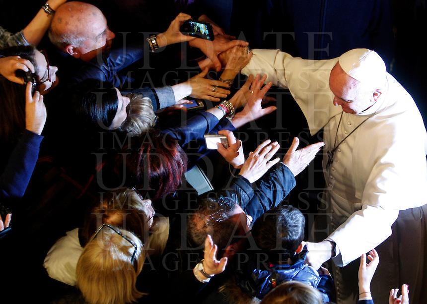 Papa Francesco saluta i fedeli al termine della veglia di preghiera per le vittime innocenti della mafia nella parrocchia di San Gregorio VII a Roma, 21 marzo 2014.<br /> Pope Francis greets faithful at the end of a vigil prayer for innocent victims of mafia, at the parish church of San Gregorio VII in Rome, 21 March 2014.<br /> UPDATE IMAGES PRESS/Riccardo De Luca<br /> <br /> STRICTLY ONLY FOR EDITORIAL USE