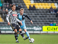 Graham Burke of Notts County plays a pass during the Sky Bet League 2 match between Notts County and Wycombe Wanderers at Meadow Lane, Nottingham, England on 28 March 2016. Photo by Andy Rowland.
