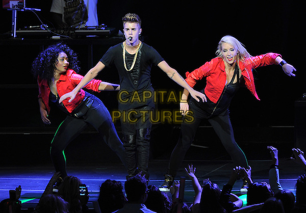 Justin Bieber.KIIS FM Jingle Ball Night 2 held at Nokia Live in Los Angeles, California, USA..3rd December 2012 .on stage in concert music gig performing live performance full length black jeans denim top dancing backup dancers red gold necklace  singing.CAP/DVS.©DVS/Capital Pictures.