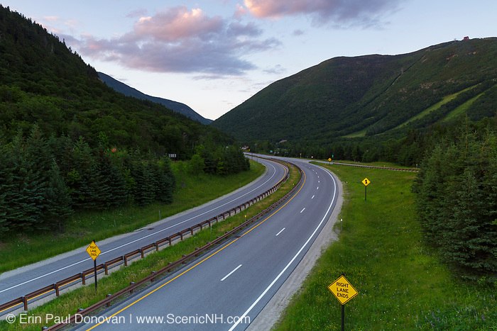 Franconia Notch Parkway in the northern section of Franconia Notch State Park in the New Hampshire White Mountains on an early summer morning. Cannon Mountain is on the right.