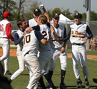 March 29, 2005:  Pitcher Dennis Raben (28 - hand in air) of St. Thomas High School celebrates with teammates after a game at Bishop Moore Catholic High School in Orlando, FL.  Raben got the win on the mound defeating nationally top ranked Monsignor Pace.  Raben attended Miami University and was drafted in the 2nd round of the 2008 MLB amateur draft by the Seattle Mariners as an outfielder.  Photo By Mike Janes/Four Seam Images