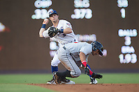 Ryan Brett (1) of the Durham Bulls holds on to the baseball after forcing out Gustavo Nunez (12) of the Indianapolis Indians at second base at Durham Bulls Athletic Park on August 4, 2015 in Durham, North Carolina.  The Indians defeated the Bulls 5-1.  (Brian Westerholt/Four Seam Images)