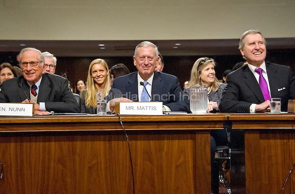 Former United States Senator Sam Nunn (Democrat of Georgia), left, and former US Secretary of Defense William Cohen, right, appear before the United States Senate Committee on Armed Services as it holds a confirmation hearing on the nomination of US Marine Corps General James N. Mattis (retired), center, to be Secretary of Defense on Capitol Hill in Washington, DC on Thursday, January 12, 2017.  Nunn and Cohen each introduced and endorsed Mattis for the post.<br /> Credit: Ron Sachs / CNP /MediaPunch