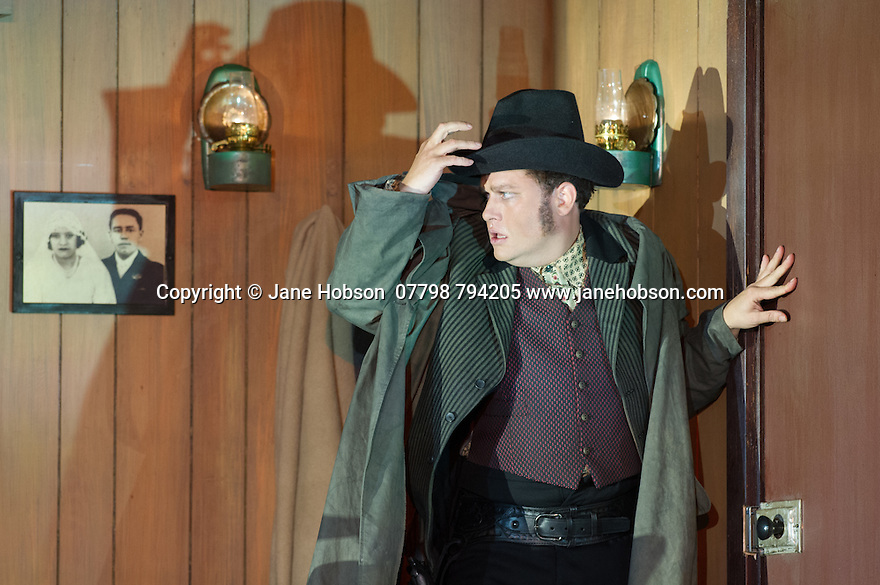 """London, UK. 30.09.2014. English National Opera's production of """"The Girl of the Golden West"""", by Giacomo Puccini, directed by Richard Jones, conducted by Keri-Lynn Wilson, opens at London Coliseum. Picture shows: Peter Auty (Dick Johnson). Photograph © Jane Hobson."""