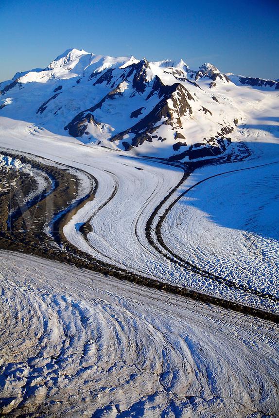 Aerial of glaciers coming together to create Colony Glacier, Chugach Mountains, Prince William Sound, Chugach National Forest, Alaska.