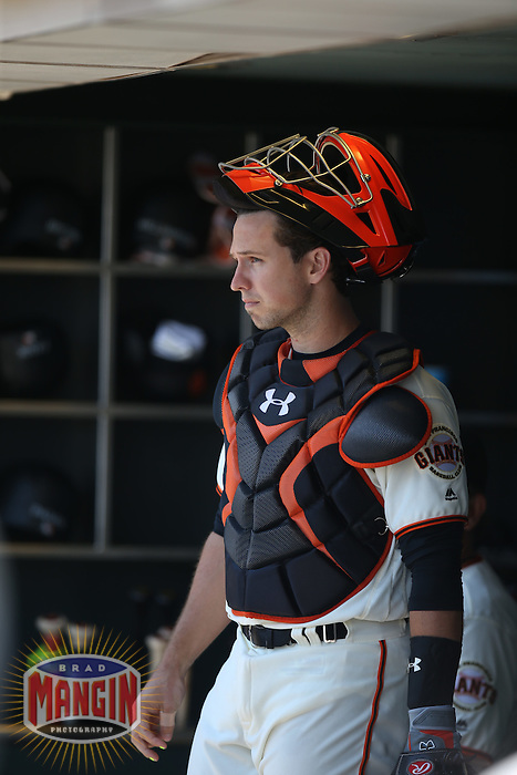 SAN FRANCISCO, CA - JULY 30:  Buster Posey #28 of the San Francisco Giants stands in the dugout before the game against the Washington Nationals at AT&T Park on Saturday, July 30, 2016 in San Francisco, California. Photo by Brad Mangin