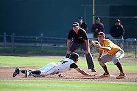 David Greer (28) of the Arizona State Sun Devils takes a throw at first base as Luke Rasmussen (44) of the Long Beach State Dirtbags slides back to the bag during a game at Blair Field on February 27, 2016 in Long Beach, California. Long Beach State defeated Arizona State, 5-2. (Larry Goren/Four Seam Images)