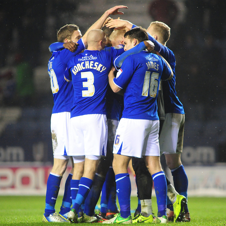 Leicester City's Kasper Schmeichel is congratulated by his team-mates after his last minute penalty save helped his team to a 1-0 win over Middlesbrough. - CREDIT - CameraSport - CHRIS VAUGHAN..Football - npower Football League Championship - Leicester City v Middlesbrough - Friday 18th January 2013 - The King Power Stadium - Leicester..© CameraSport - 43 Linden Ave. Countesthorpe. Leicester. England. LE8 5PG - Tel: +44 (0) 116 277 4147 - admin@camerasport.com - www.camerasport.com