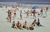 People enjoying at beach in Wildwood, New Jersey. 1960's