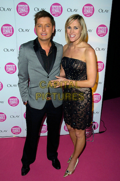 BRIAN DOWLING & JENNI FALCONER.Cosmopolitan Fun Fearless Female Awards 2007 held at Cirque, Leicester Square, London, England. .November 6th 2007 .full length grey gray suit jacket black lace dress strapless beige shoes.CAP/CAN.©Can Nguyen/Capital Pictures