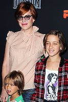 "CENTURY CITY, CA, USA - SEPTEMBER 27: Molly Ringwald, Roman Stylianos Gianopoulos, Mathilda Ereni Gianopolous arrive at the Los Angeles Screening Of Disney XD's ""Star Wars Rebels: Spark Of Rebellion"" held at the AMC Century City 15 Theatre on September 27, 2014 in Century City, California, United States. (Photo by Celebrity Monitor)"