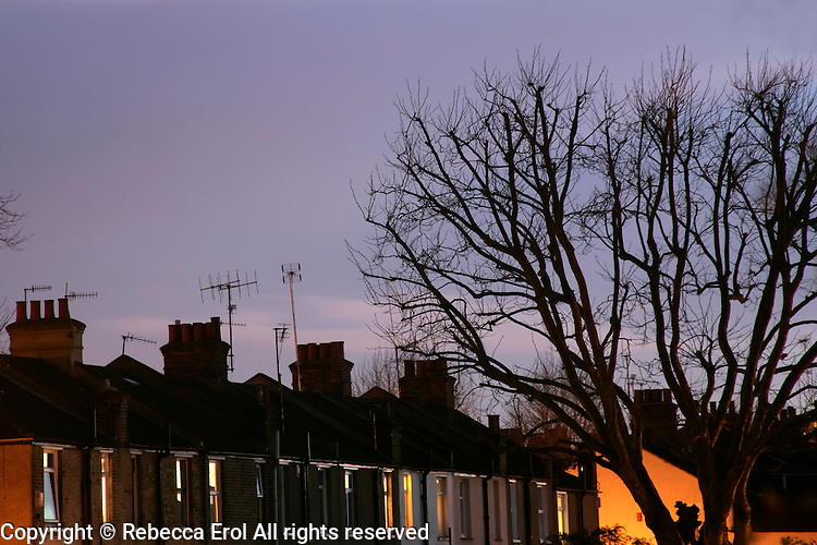 Row of terraced houses at dusk, London, UK