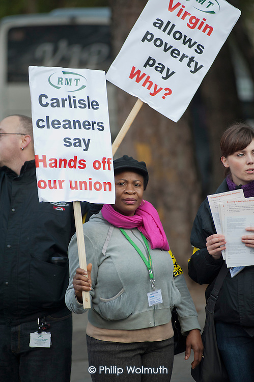 Cleaners on Virgin West Coast Mainline trains picket Euston Station during a one-day national strike over attempts by employer Carlisle Cleaning and Support Services to derecognise the RMT union and impose a 1% pay rise.