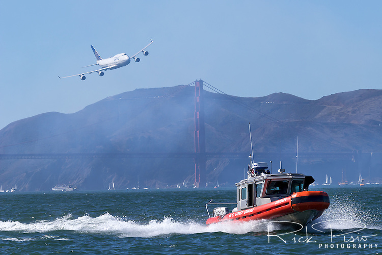 United Airlines Boeing 747-400 chases down a USCG Defender Class Response Boat (RB-S) along the San Francisco Waterfront