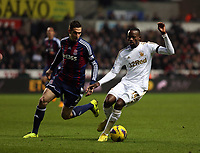 Saturday 19 January 2013<br /> Pictured: Roland Lamah of Swansea (R) against Geoff Cameron of Stoke (L).<br /> Re: Barclay's Premier League, Swansea City FC v Stoke City at the Liberty Stadium, south Wales.