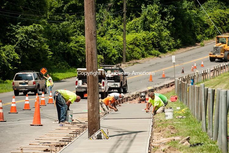 WATERBURY, CT-22 July 2014-072214EC04-  Crews install new sidewalks along Oronoke Road in Waterbury Tuesday afternoon. The sidewalks run along Holy Cross High School's campus. Erin Covey Republican-American