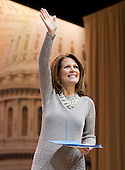 United States Representative Michele Bachman (Republican of Minnesota) waves to the crowd after speaking at the Conservative Political Action Conference (CPAC) at the Gaylord National at National Harbor, Maryland on Saturday, March 8, 2014.<br /> Credit: Ron Sachs / CNP