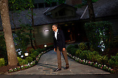 United States President Barack Obama waits to greet G8 leaders in front of Laurel Lodge at Camp David during the 2012 G8 Summit on Friday, May 18, 2012 in Camp David, Maryland. Leaders of eight of the worlds largest economies meet over the weekend in an effort to keep the lingering European debt crisis from spinning out of control. .Credit: Luke Sharrett / The New York Times / Pool via CNP