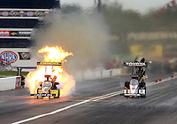 Aug 30, 2014; Clermont, IN, USA; NHRA top fuel dragster driver Antron Brown (right) races alongside Richie Crampton as he explodes an engine on fire during qualifying for the US Nationals at Lucas Oil Raceway. Mandatory Credit: Mark J. Rebilas-USA TODAY Sports