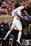 20 March 2008: Sacha Kljestan (USA) (16) jumps into the arms of teammates after scoring the game's final goal. The United States U-23 Men's National Team defeated the Canada U-23 Men's National Team 3-0 at LP Field in Nashville,TN in a semifinal game during the 2008 CONCACAF Men's Olympic Qualifying Tournament. With the victory, the United States qualified for the 2008 Beijing Olympics.