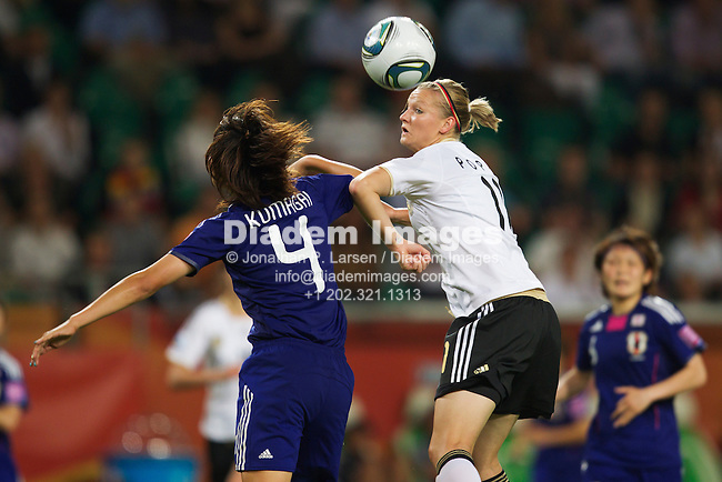 WOLFSBURG, GERMANY - JULY 9:  Saki Kumagai of Japan (l) and Alexandra Popp of Germany (r) jump for a header during a 2011 Women's World Cup quarterfinal soccer match July 9, 2011 at Arena Im Allerpark in Wolfsburg, Germany.  Editorial use only.  (Photograph by Jonathan P. Larsen)