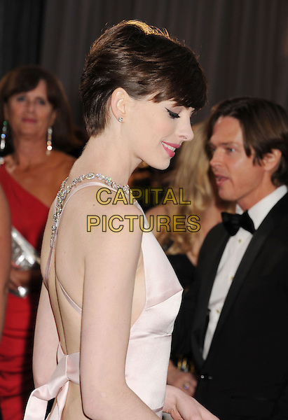 Anne Hathaway (wearing Prada).85th Annual Academy Awards held at the Dolby Theatre at Hollywood & Highland Center, Hollywood, California, USA..February 24th, 2013.oscars half length pink sleeveless silk satin dress backless straps jewel encrusted embellished side profile .CAP/ROT/TM.©Tony Michaels/Roth Stock/Capital Pictures Oscars