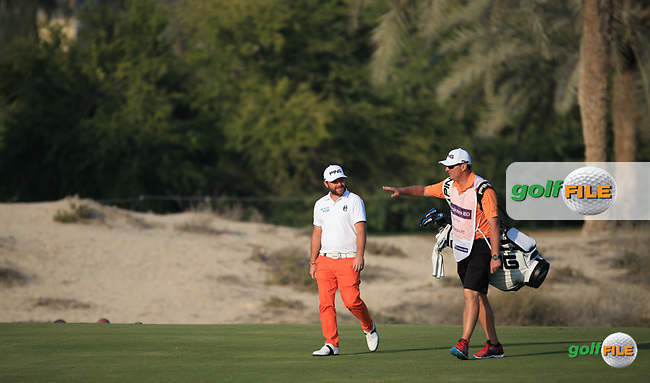 Andy Sullivan (ENG) and caddie Sean head down the 14th during the Pro-Am at the 2016 Omega Dubai Desert Classic, played on the Emirates Golf Club, Dubai, United Arab Emirates.  03/02/2016. Picture: Golffile | David Lloyd<br /> <br /> All photos usage must carry mandatory copyright credit (&copy; Golffile | David Lloyd)