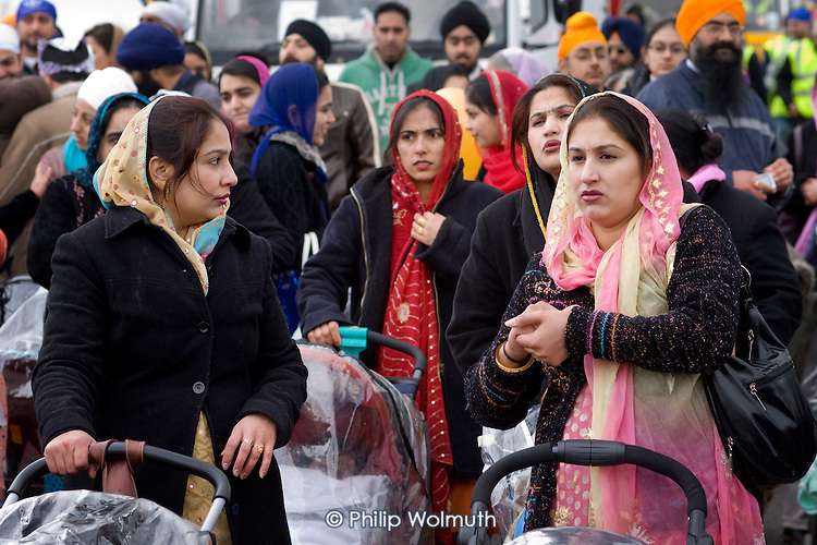 Mothers with pushchairs join thousands of local residents on a procession through Southall, West London, to celebrate the Sikh festival of Vaisakhi.