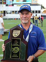 Armwood Hawks head coach Sean Callahan poses with the state title trophy after the Florida High School Athletic Association 6A Championship Game at Florida's Citrus Bowl on December 17, 2011 in Orlando, Florida.  Armwood defeated Miami Central 40-31.  (Mike Janes/Four Seam Images)