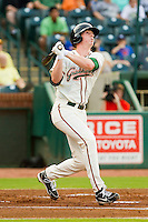 Greensboro Grasshoppers third baseman Colin Moran (14) connects on a solo home run in his first at bat as a professional against the Charleston RiverDogs at NewBridge Bank Park on July 17, 2013 in Greensboro, North Carolina.  The Grasshoppers defeated the RiverDogs 4-3.  (Brian Westerholt/Four Seam Images)