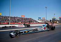 Apr 14, 2019; Baytown, TX, USA; NHRA top fuel driver Antron Brown (near) races alongside Steve Torrence during the Springnationals at Houston Raceway Park. Mandatory Credit: Mark J. Rebilas-USA TODAY Sports