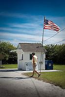 Visitor checks out smallest US Post Office, Ochoppee, Florida, USA. Photo by Debi PIttman Wilkey