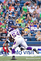 Seattle Seahawks quarterback Tarvaris Jackson (7) is tackled by Minnesota Vikings linebacker Jasper Brinkley (54) while passing the ball upfield at CenturyLink Field in Seattle, Washington. The Minnesota Vikings won the game, 20-7.