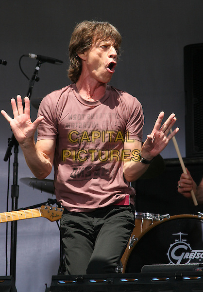 MICK JAGGER.The Rolling Stones Kick Off World Tour with Surprise Performance, Julliard Music School Plaza, New York City, USA, May 10th 2005..half length concert gig arms funny hands gesture pose.Ref: IW.www.capitalpictures.com.sales@capitalpictures.com.©Ian Wilson/Capital Pictures.