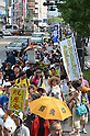August 6, 2011, Hiroshima, Japan - Activists of all sorts march through the City of Hiroshima, calling for No Nuclear Bombs and No Nuclear Plants in a peace demonstration after a memorial ceremony at Peace Memorial Park in Hiroshima on Saturday, August 6, 2011....Japan observed the 66th anniversary of the atomic bombing with a moment of silence and the release of doves in a memorial ceremony as the nation struggles to put a different kind of nuclear disaster under control at the crippled power plant in northeast. The worlds first A-bomb destroyed most of this western industrial city, killing as many as 140,000 people in the summer of 1945. A second atomic bombing Aug. 9 that year in Nagasaki killed tens of thousands more and prompted the Japanese to surrender. (Photo by Natsuki Sakai/AFLO [3615] -mis-