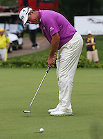 With two holes to go, the contenders floundering, all Lee Westwood (ENG) has to do is keep his nerve during the Final Round of the 2014 Maybank Malaysian Open at the Kuala Lumpur Golf & Country Club, Kuala Lumpur, Malaysia. Picture:  David Lloyd / www.golffile.ie