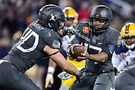Baltimore, MD - DEC 10, 2016: Army Black Knights quarterback Ahmad Bradshaw (17) hands the ball of to Army Black Knights running back Andy Davidson (40) during game between Army and Navy at M&T Bank Stadium, Baltimore, MD. (Photo by Phil Peters/Media Images International)