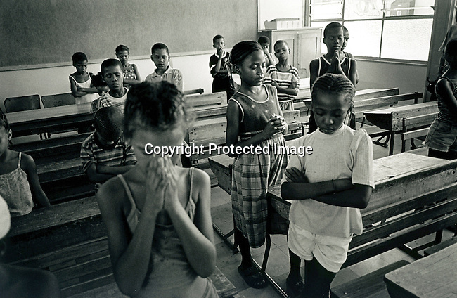 disiabu00043.Social Issues. Abuse. A children's choir rehearsing at the Olyfenshoutsdrift primary school on February 8, 2002 in Loisevale, Upington. Baby Thsepang, an 8 month old baby was raped in the community in October-2002. The community has high unemployment..©Per-Anders Pettersson/iAfrika Photos