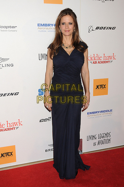 "Kelly Preston.10th Annual ""Living Legends of Aviation"" Awards held at the Beverly Hilton Hotel, Beverly Hills, California, USA, .18 January 2013..full length blue navy ruched dress long maxi .CAP/ADM/BP.©Byron Purvis/AdMedia/Capital Pictures."