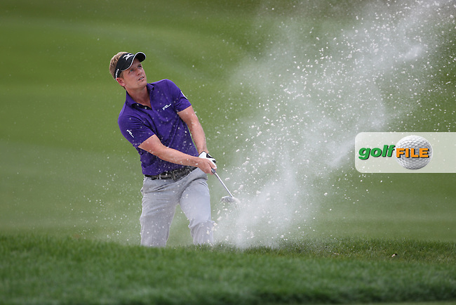 Luke Donald of England chips out of a bunker onto the 1st green during the 3rd round of the Valspar Championship, Innisbrook Resort (Copperhead), Palm Harbor, Florida, USA<br /> Picture: Peter Mulhy / Golffile