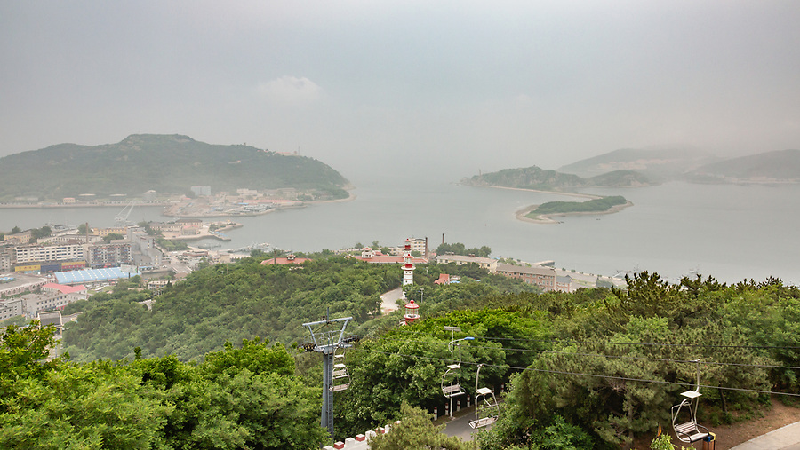 View Of The Lushun (Port Arthur) Harbour Area From White Jade Mountain. Note The Three Lighthouses Lined Up To Guide Ships Into The Narrow Entrance Of The Harbour.