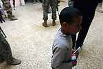 A boy in the city of Mosul, Iraq clutches a leaflet given to him by an Iraqi soldier that urges residents not to cooperate with terrorists and to call in tips to authorities about al Qaida and other insurgent groups.  U.S. commanders say a string of new combat outposts and daily patrols by U.S. and Iraqi forces are pushing insurgents out of the city. March 1, 2008. DREW BROWN/STARS AND STRIPES