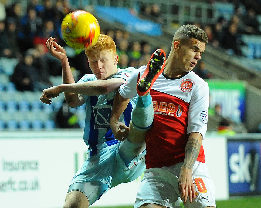 Coventry City's Ryan Haynes vies for possession with Fleetwood Town's Tyler Forbes<br /> <br /> Photographer Kevin Barnes/CameraSport<br /> <br /> Football - The Football League Sky Bet League One - Coventry City v Fleetwood Town - Saturday 20th December 2014 - The Ricoh Arena - Coventry<br /> <br /> &copy; CameraSport - 43 Linden Ave. Countesthorpe. Leicester. England. LE8 5PG - Tel: +44 (0) 116 277 4147 - admin@camerasport.com - www.camerasport.com