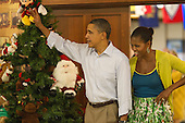 United States President Barack Obama and first lady Michelle Obama greet current and retired members of the U.S. military and their families as they eat a Christmas Day meal at Anderson Hall mess hall at Marine Corps Base Hawaii on Sunday, December 25, 2011 in Kaneohe, Hawaii.  .Credit: Kent Nishimura / Pool via CNP